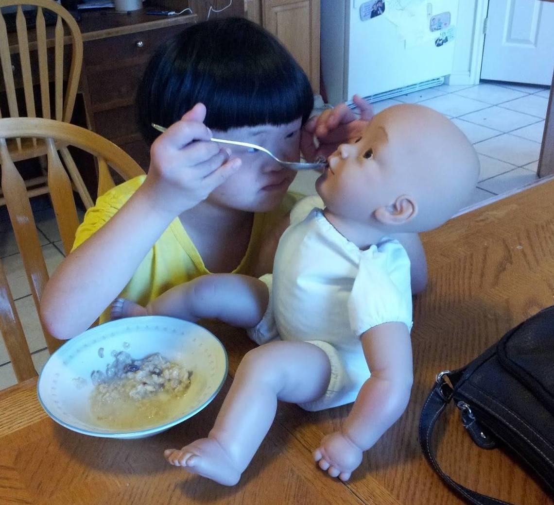 Rebecca feeding baby